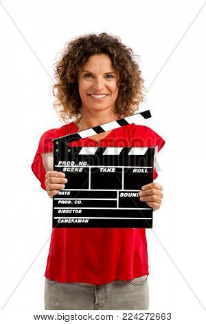 Portrait of a smiling middle aged brunette holding a clapboard