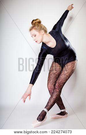 Modern Style Woman Ballet Dancer Full Length On Gray