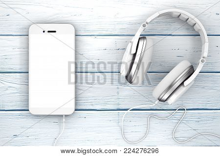 Headphones near Mobile Phone with Blank Touchscreen for Yours Design on a wooden table. 3d Rendering.