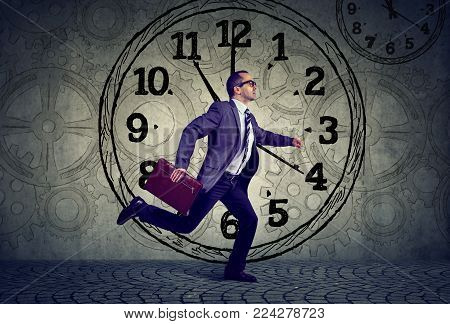Mature business man in suit running out of time
