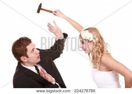 Wedding couple having argument - conflict, bad relationships. Angry woman fury bride and groom in fight. Isolated on white