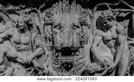 Stone bas-relief of lion and gods