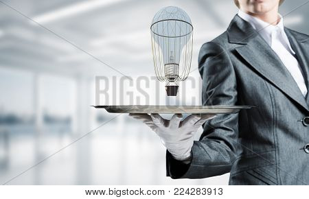 Closeup of waiter's hand in glove presenting flying aerostat on metal tray with office view on background. 3D rendering.