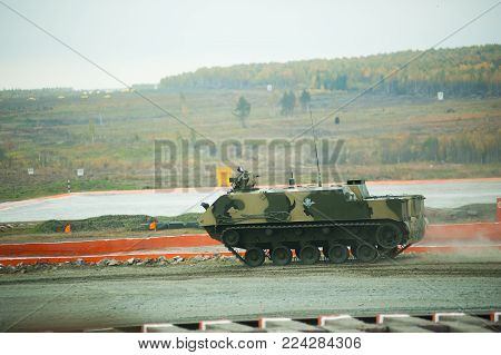 Nizhniy Tagil, Russia - September 25. 2013: Airborne tracked armoured personnel carrier BTR-MDM Rakushka-M on demonstration range. Russia Arms Expo-2013 exhibition