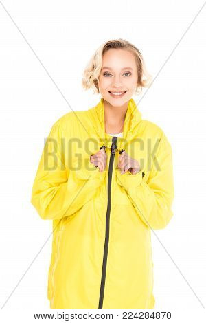 portrait of beautiful smiling woman in yellow raincoat isolated on white