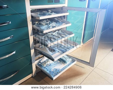 Cabinet with medical instruments and tools equipment in the ENT doctor's office