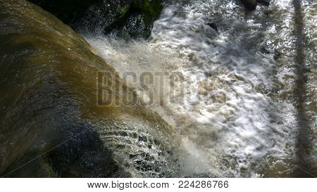 A fast flowing river at a waterfall in Dunfermline