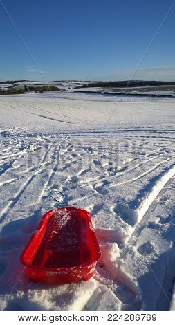 A plastic sledge ready for some winter sports fun