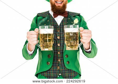 cropped view of leprechaun celebrating st patricks day with beer, isolated on white