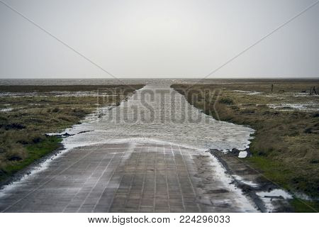 Causeway to the island of Mando at high tide. The Danish part of the Wadden Sea National Park.