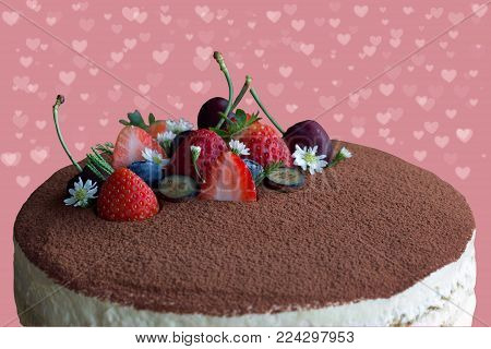 Round tiramisu cake on sweet pink and heart shape isolated background with clipping paths. Tiramisu is an Italian classic dessert so sweet and delicious for Valentines or birthday. Homemade bakery concept of Tiramisu. Sweet cake on sweet background.