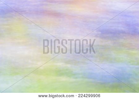 Abstract blurred flower meadow with movement effect.  Natural background in subtle tones with directional blur, motion effect and long exposure.