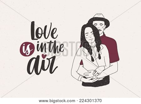 Man in hat standing behind woman with braids and embracing her and Love Is In The Air lettering on light background. Beautiful young couple in love. Vector illustration for Valentine s day postcard