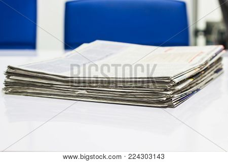 Close-up Stack of newspapers For information on the desk in the office.
