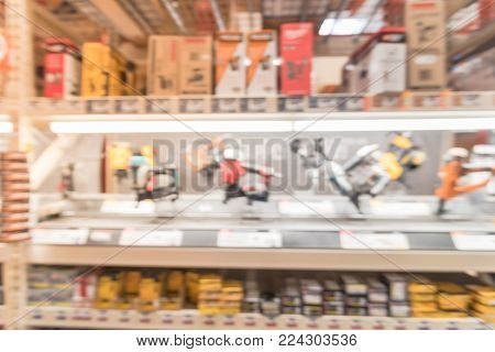 Blurred Row Of Power Tool Combo Kits At Hardware Store In America