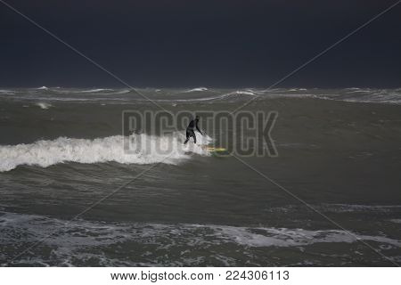 Man Surfing Barrel Wave In The Sea