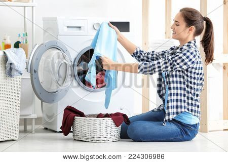 Young woman doing laundry at home