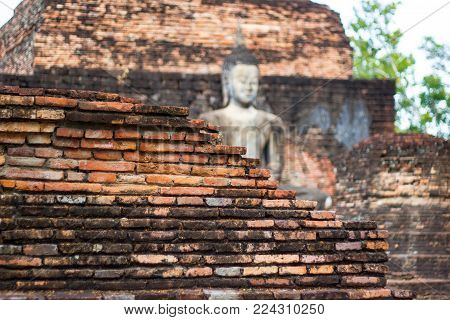 Closeup - the old brick ancient wall at Sukhothai history park and the ruins of the royal temple, which is the most important in the province, Thailand. (selective focus red old Brick)