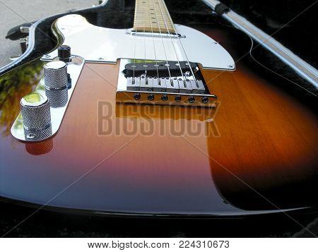 Vintage Electric Sunburst Color Guitar In open Case