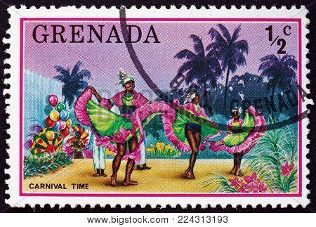 GRENADA - CIRCA 1976: a stamp printed in Grenada shows carnival dancers, tourist publicity, circa 1976
