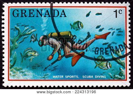 GRENADA - CIRCA 1976: a stamp printed in Grenada shows scuba diving, tourist publicity, circa 1976