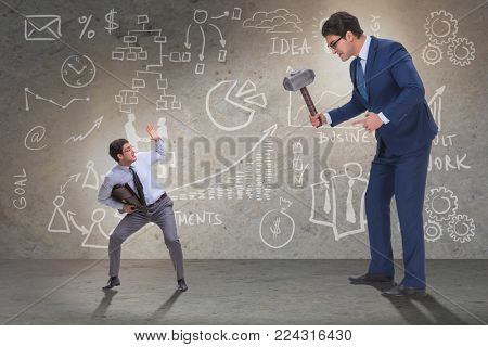 Bad angry boss threatening employee with hammer