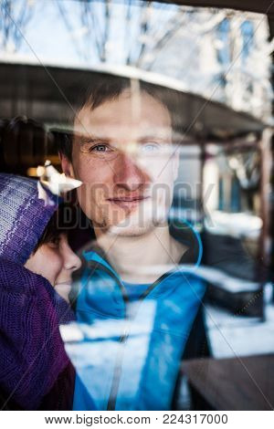 Couple In Reflection Of Glass.