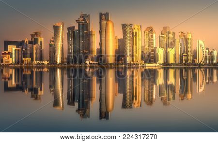 The skyline of West Bay and Doha City Center during sunret, Qatar
