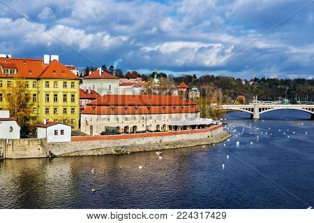 Prague city with building of Franz Kafka Museum view from Charles bridge, Czech Republic.