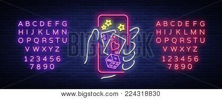 Online casino is a neon sign. Logo symbol in neon style svityaschyysya bright banner billboard night, bright neon poker, gambling casino. Play money online. Vector illustration. Editing text neon sign