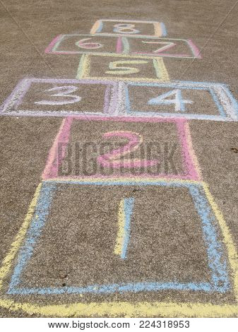 Hopscotch game drawn out with chalk with nobody.