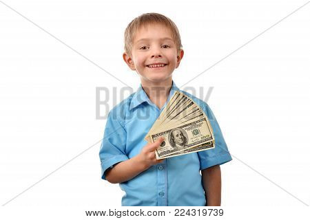 The boy is a businessman. A man holds dollars. The boy has money in his hand. Good profit. The offer for a child. The pocket expenses.