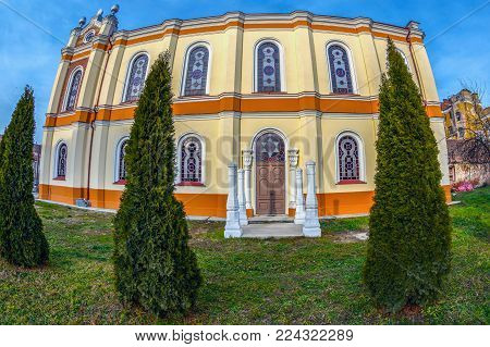 ORADEA, ROMANIA - JANUARY 27, 2018: Back exterior of the Orthodox Synagogue with traditional columns place for wedding. It was built in 1890 after the plans of Knapp Ferencz in neo-maorical style.