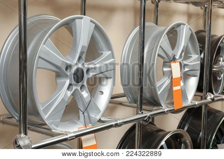 Rack with car wheels in automobile store