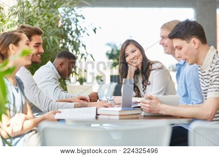 Interracial team of students work group session in school