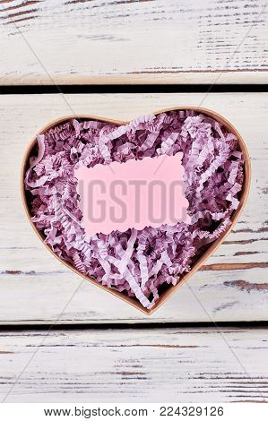 Blank greeting card mock up in open gift box. Soft pink and violet. Love confession idea, St. Valentine's Day concept.