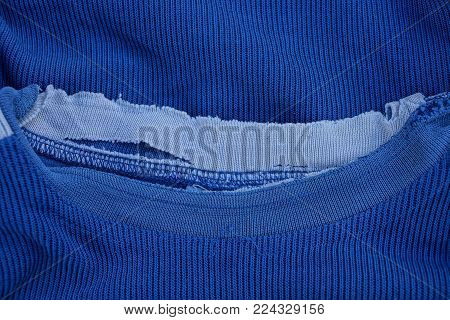 blue fabric texture with a tattered collar
