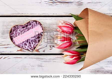 Pink tulips and gift box with message mockup. Elegant mono bouquet with craft paper wrapping. Simple and heart-touching present.
