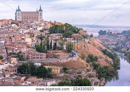 Old city of Toledo with Alcazar and river Tajo at dusk, Castilla La Mancha, Spain