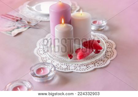 Valentines day decorated table with red hearts.Romantic table setting for Valentines day