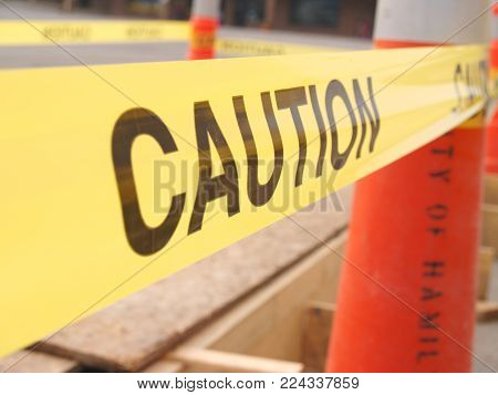 A caution taped construction site with nobody.
