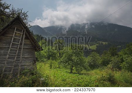 Old abandoned country shack in the mountain