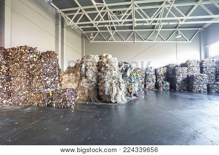 Stock of plastic pressed bales at the modern waste hazardous processing plant. Separate garbage collection. Recycling sorting and storage of waste for further disposal.