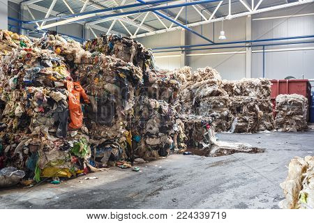 Plastic pressed bales at the modern waste hazardous processing plant. Separate garbage collection. Recycling and storage of waste for further disposal. Business for sorting and processing of waste.