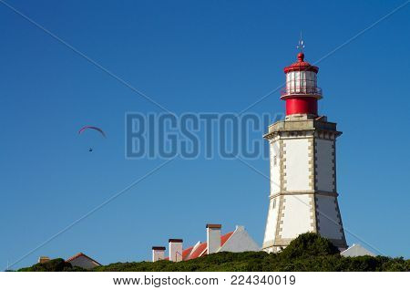 Paragliding By Lighthouse At Cape Espichel