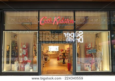 Bracknell,England - November 22, 2017: A customer in the doorway of the Cath Kidston store in Bracknell, England. The retail brand sells home furnishings and fashion accessories in stores and online
