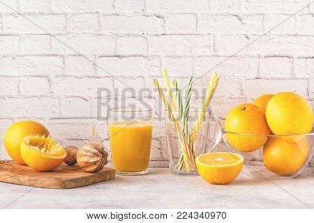 Oranges And Juicer For Making Orange Juice.