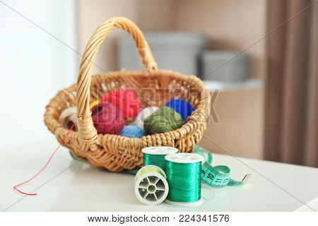 Green sewing threads with crocheting clews on table indoors