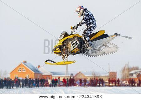 Tyumen, Russia - December 26. 2009: Sport snowmobile racing on championship of Ural region. Sportsman on snowmobile on track