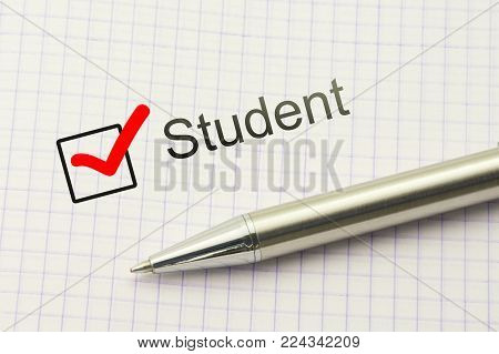 Student questionnaire choice. Marked checkbox with a silver pen on paper background. Education survey. Occupation concept.